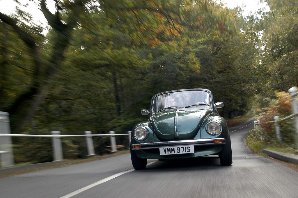A 1978 Volkswagen Beetle Cabriolet driving; if you're buying a classic car, don't skip the test drive.