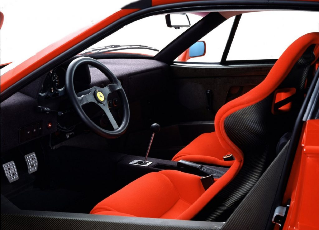 The carbon-fiber interior of a red 1987 Ferrari F40 with red seats