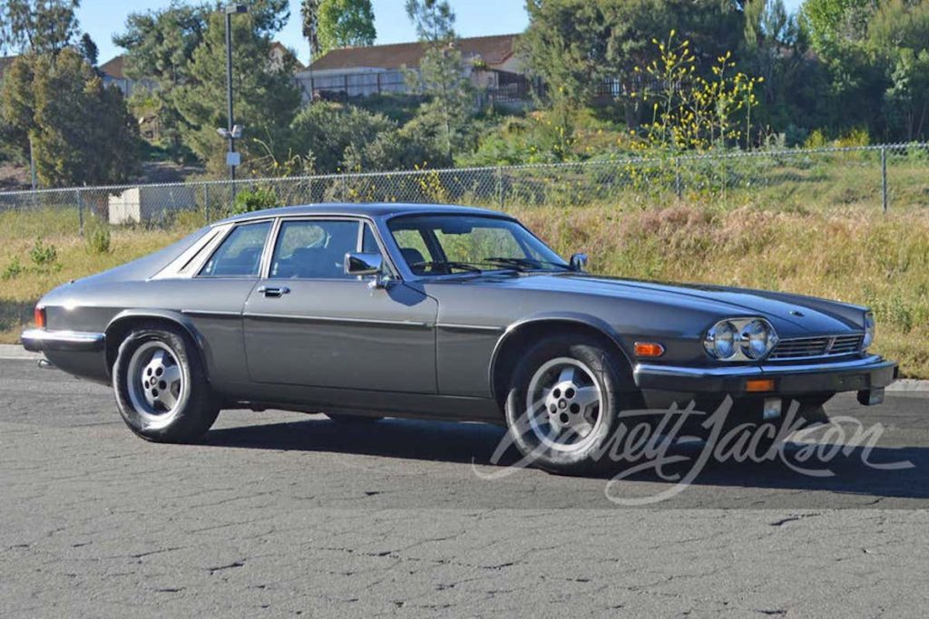 profile shot of blue 1987 Jaguar XJS sold at Barrett-Jackson