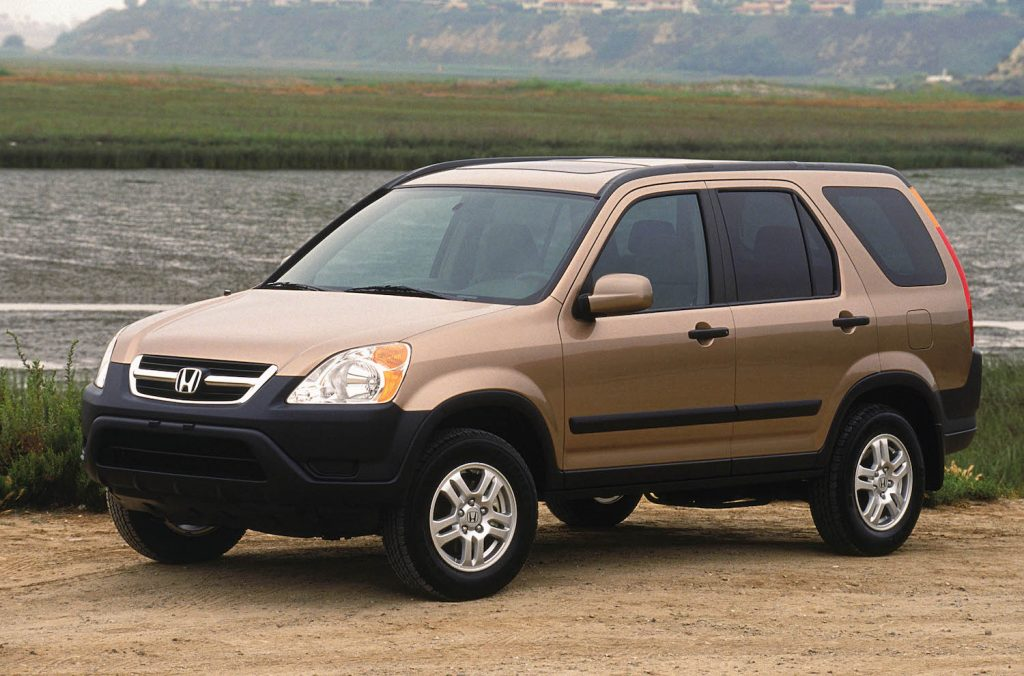 A gold 2004 Honda CR-V parked down by the river