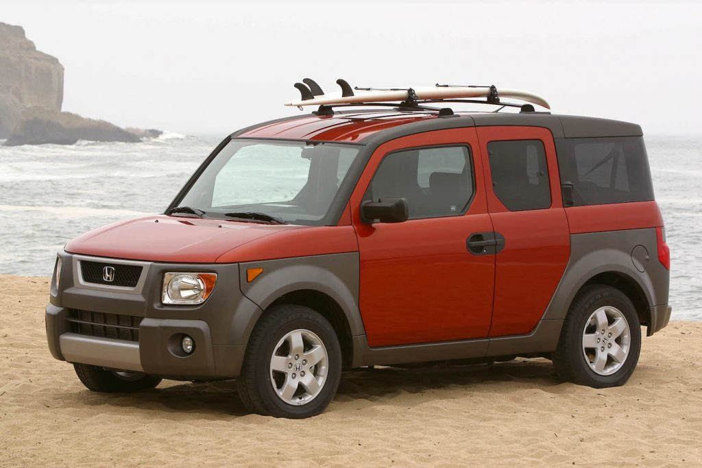 An orange 2004 Honda Element at the beach, the Element is one of the best cheap used SUVs under $5,000