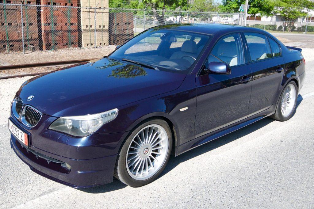 A blue 2005 BMW Alpina B5 in a parking lot