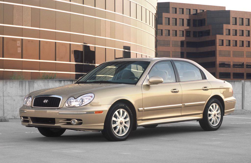 A gold 2005 Hyundai Sonata parked