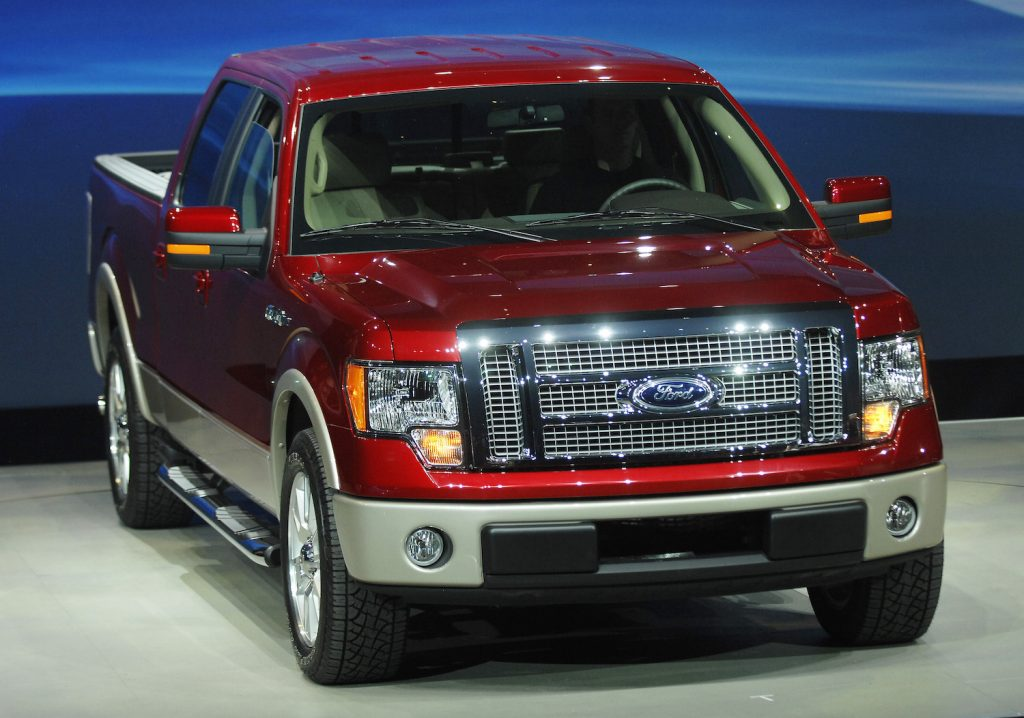 A red 2009 Ford F-150, an affordable used pickup under $25,000