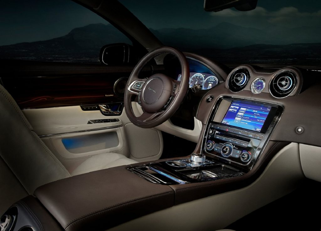 The brown-and-beige-leather-upholstered driver's side front interior of a 2012 Jaguar XJ