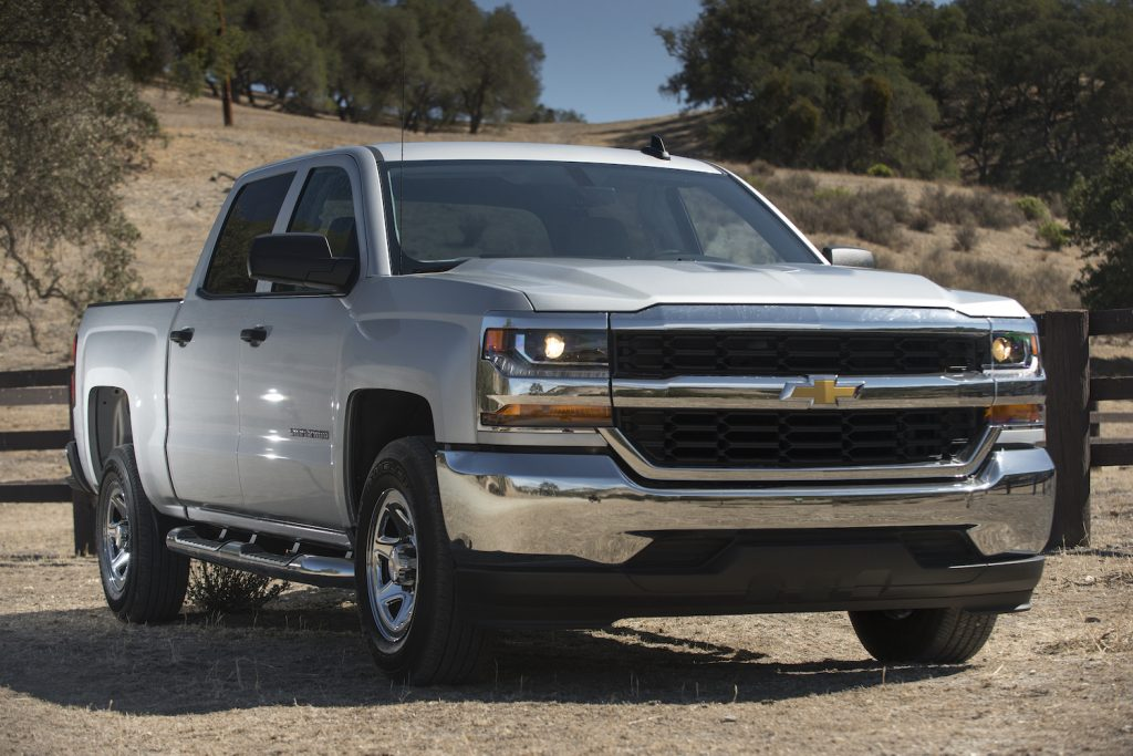 A silver 2016 Chevrolet Silverado parked, one of the best used trucks under $25,000