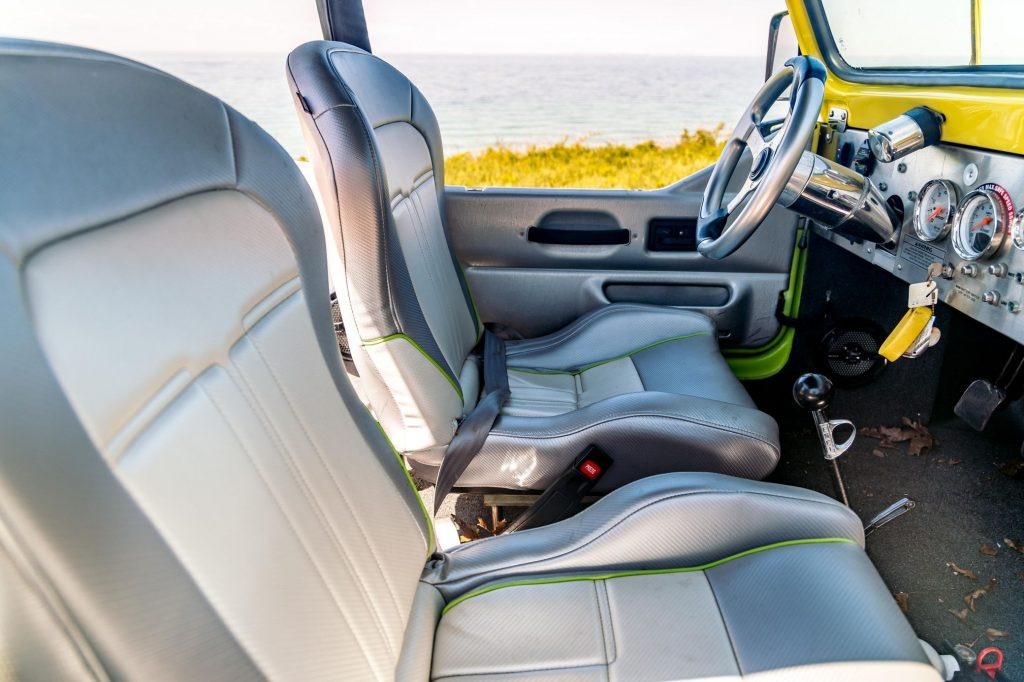 The gray-vinyl seats and gray-and-green dashboard of a 2016 WaterCar Panther