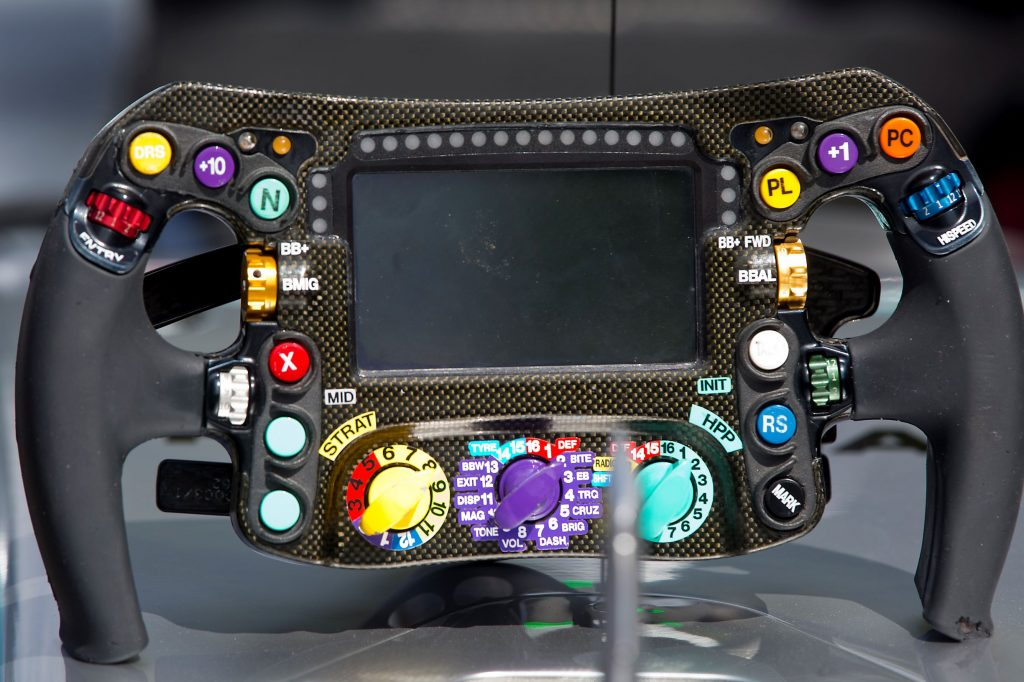 The carbon-fiber 2017 Mercedes F1 car steering wheel on a display stand