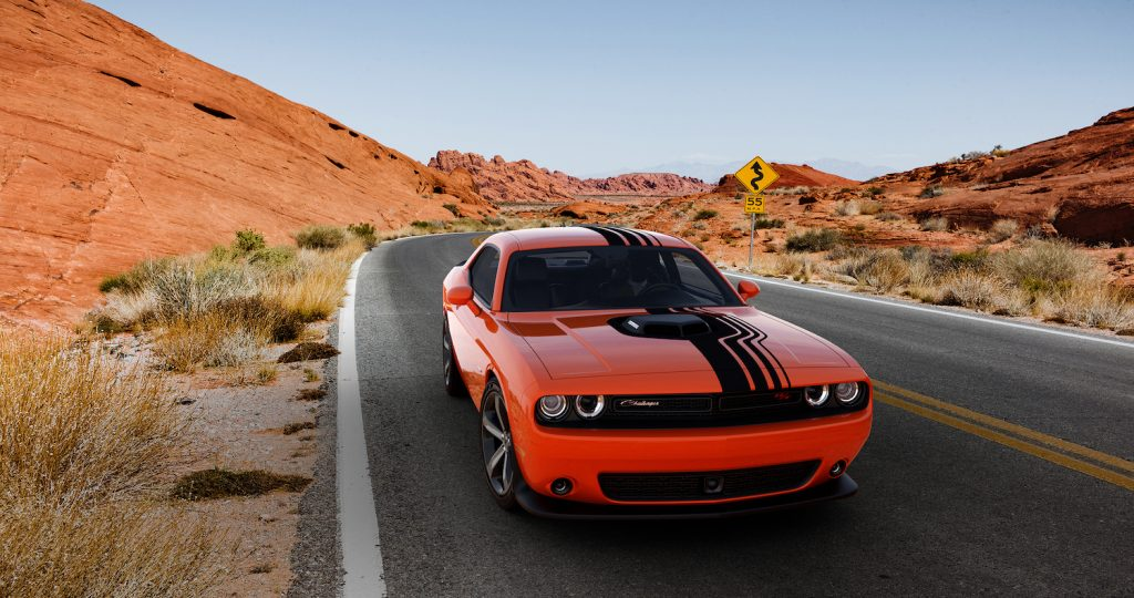 An orange 2018 Dodge Challenger, one of the best used sports cars for summer