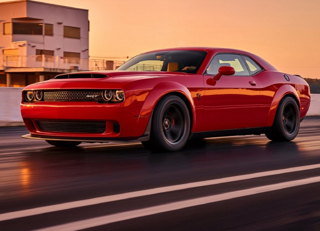 A red 2018 Dodge SRT Demon driving down a prepped dragstrip