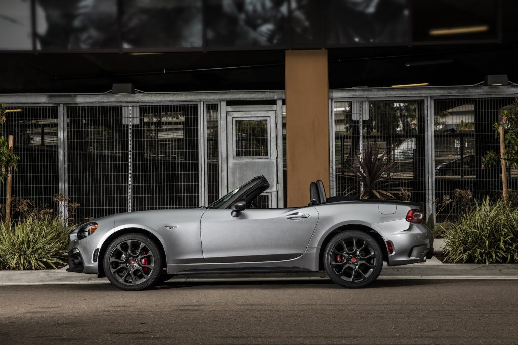 A silver 2018 Fiat 124 Spider parked outside