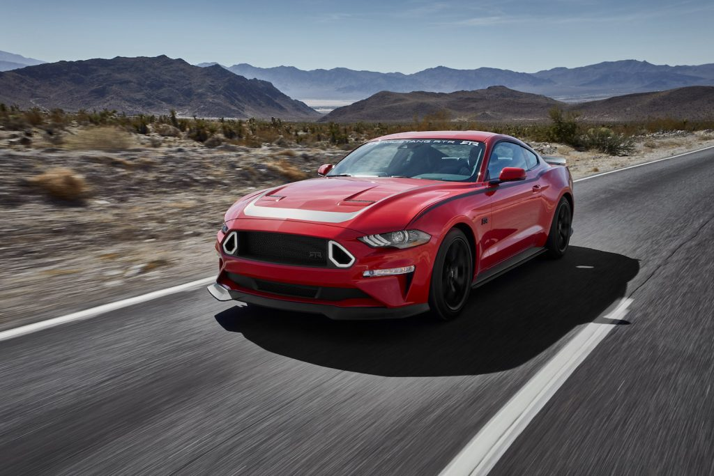 A red 2018 Ford Mustang driving