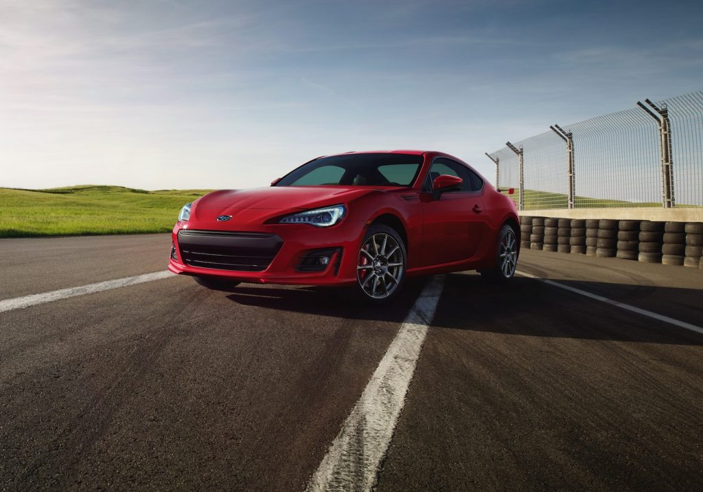 A red 2018 Subaru BRZ parked on the track, the BRZ is one of the best used sports cars for summer