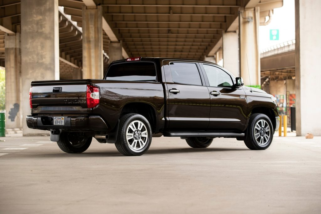 A brown Toyota Tundra sits under an overpass