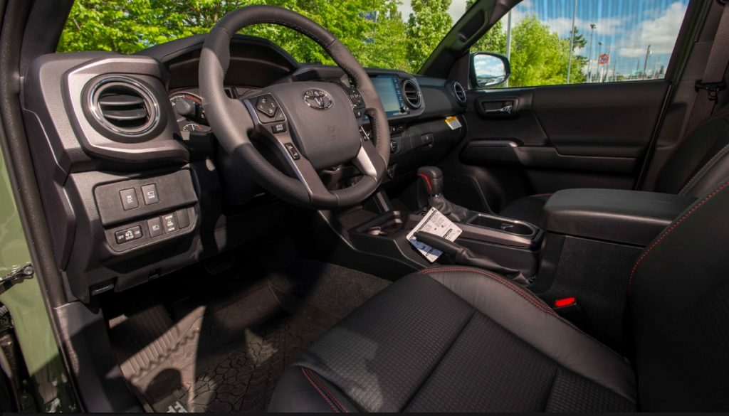 The black-and-red front interior of the one-millionth Tacoma, a 2020 Toyota Tacoma TRD Pro