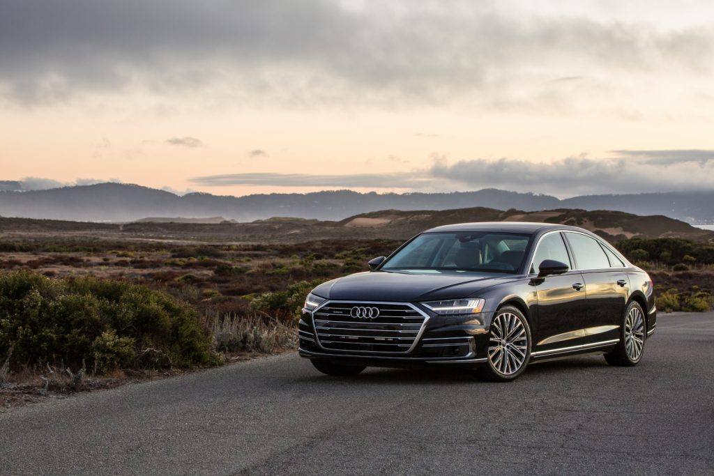 A 2021 Audi A8 parked by a mountain range, the 2021 Audi A8 is a spacious luxury sedan