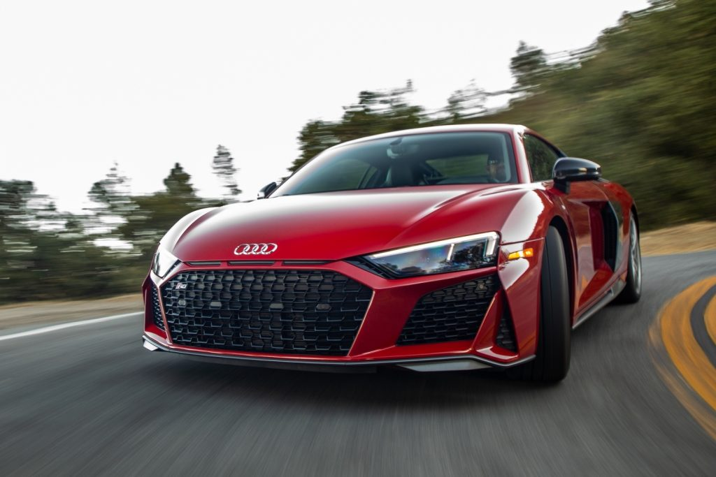 A red 2021 Audi R8 driving, the R8 is one of the best new sports cars with all-wheel drive