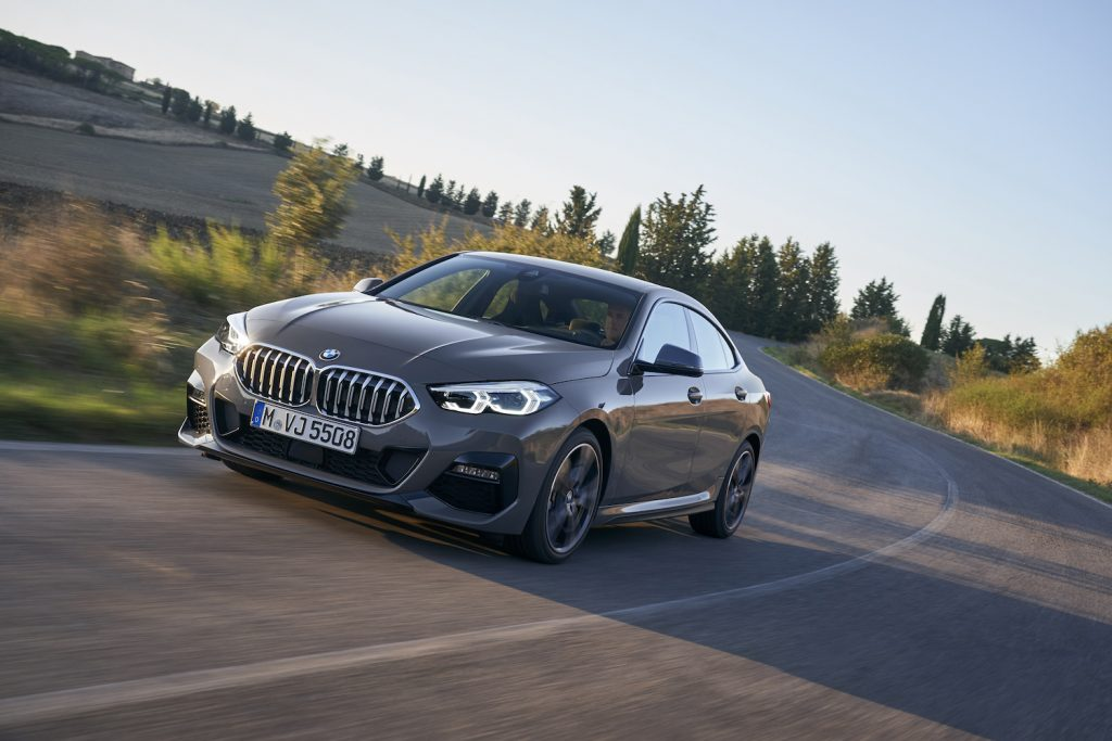 A grey 2021 BMW 2 Series Gran Coupe driving, the 2021 BMW 2 Series Gran Coupe is one of the best new luxury cars according to Consumer Reports