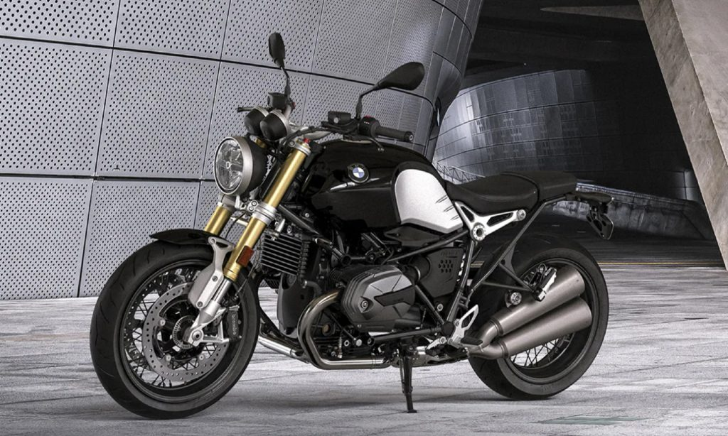 A black-and-silver 2021 BMW R nineT in a gray building