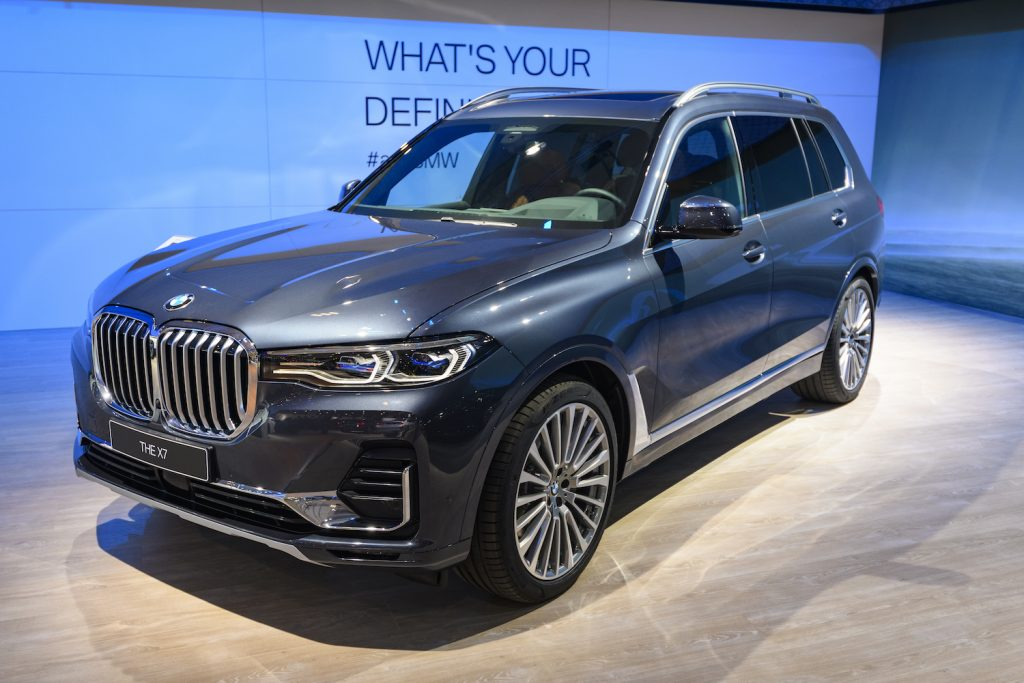 A BMW X7 at an auto show, the X7 is one of the best luxury SUVs for tall drivers
