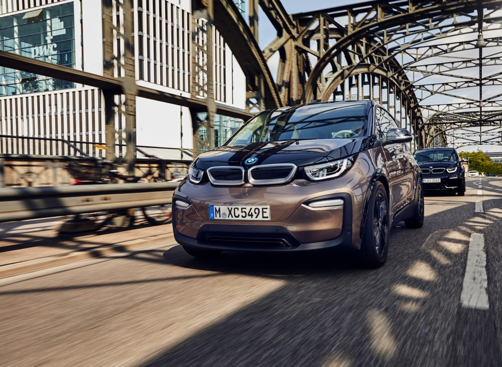 A 2021 BMW i3 driving, the 2021 BMW i3 is one of the best electric cars with over 100 MPGe