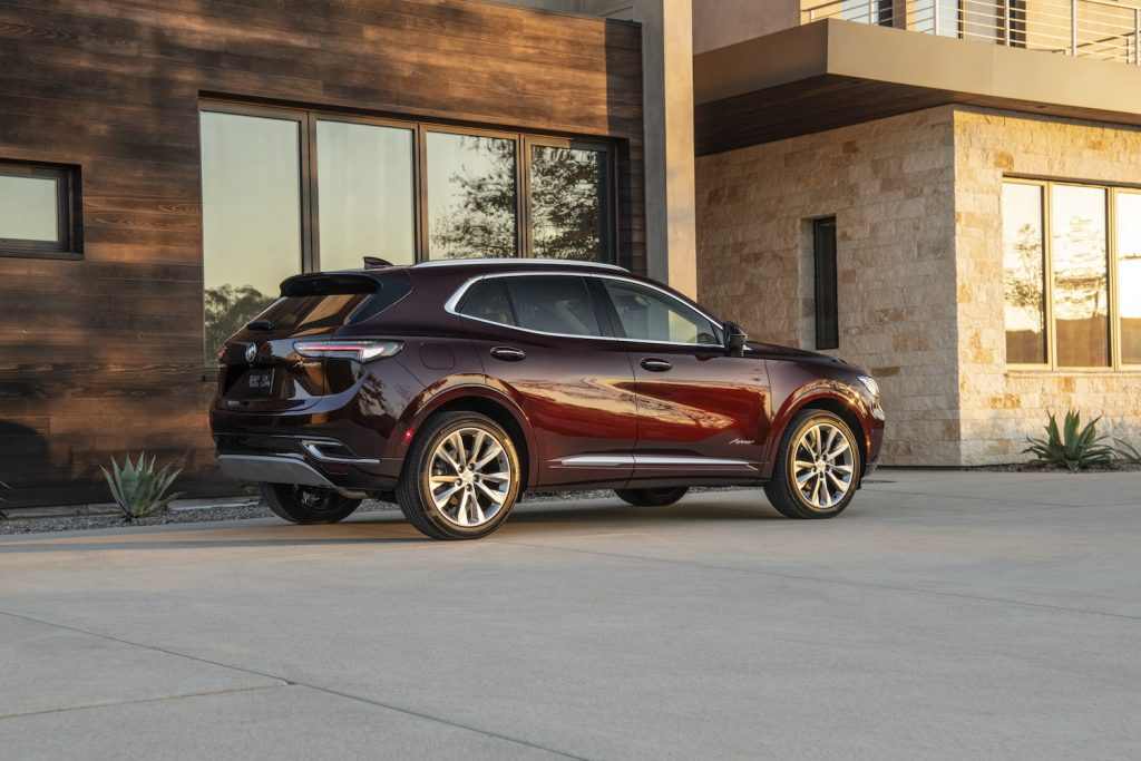 A 2021 Buick Envision parked in front of a house