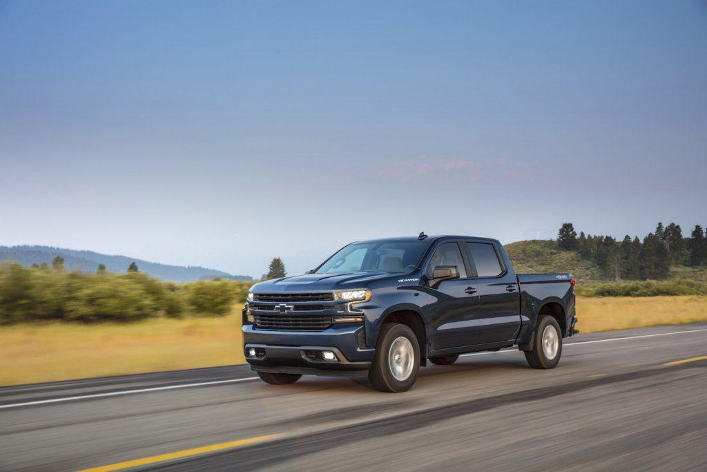 A dark blue 2021 Chevrolet Silverado RST driving, the Silverado is one of the best new diesel trucks