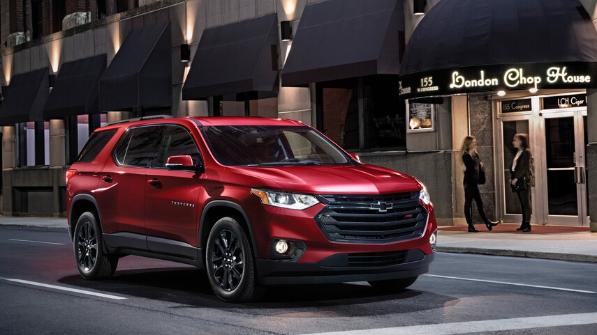 A red 2021 Chevy Traverse parked at a traffic light