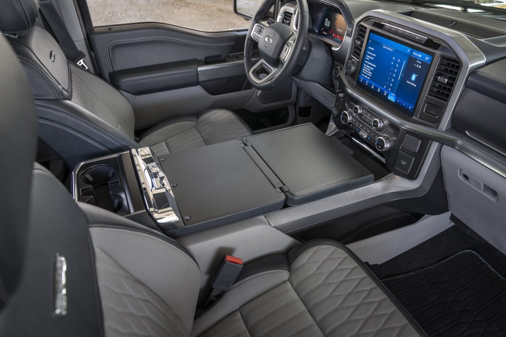 A 2021 Ford F-150 pickup truck interior with dark-gray ventilated seats