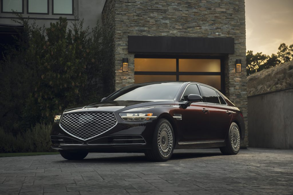 A maroon 2021 Genesis G90 parked, the G90 is one of the best luxury cars for tall drivers