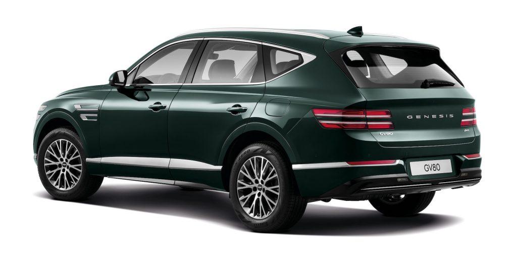 A dark-green 2021 Genesis GV80 luxury midsize SUV on a white background