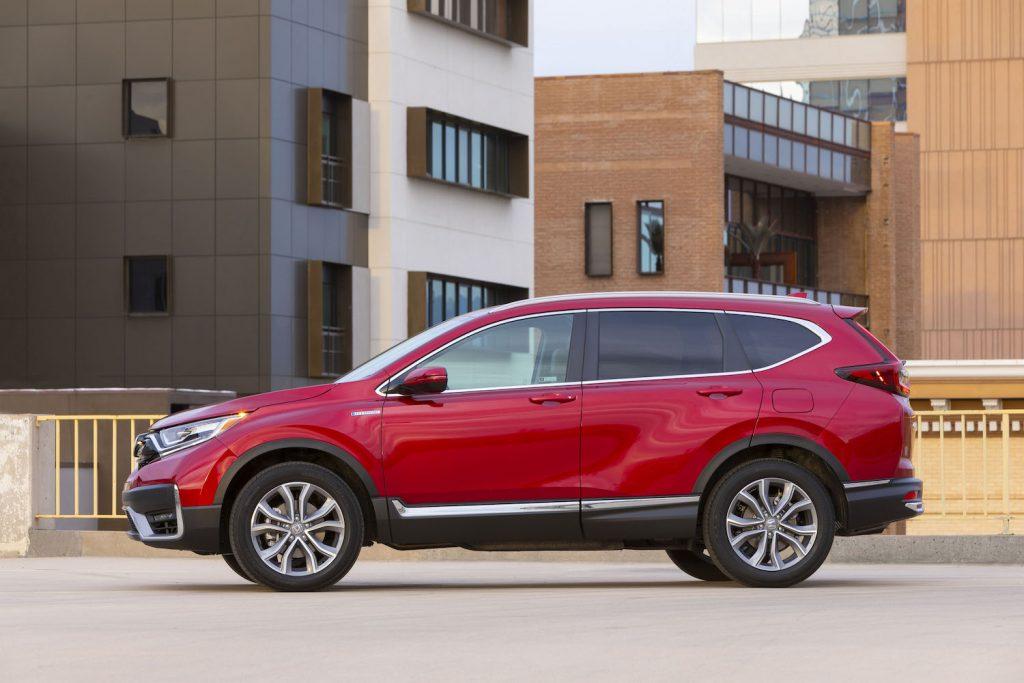 A red 2021 Honda CR-V Hybrid SUV parked