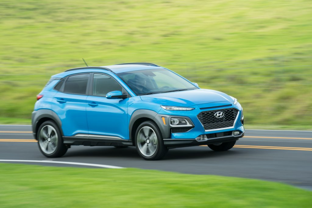 A blue 2021 Hyundai Kona driving, the 2021 Hyundai Kona is one of the most affordable new SUVs under $30,000