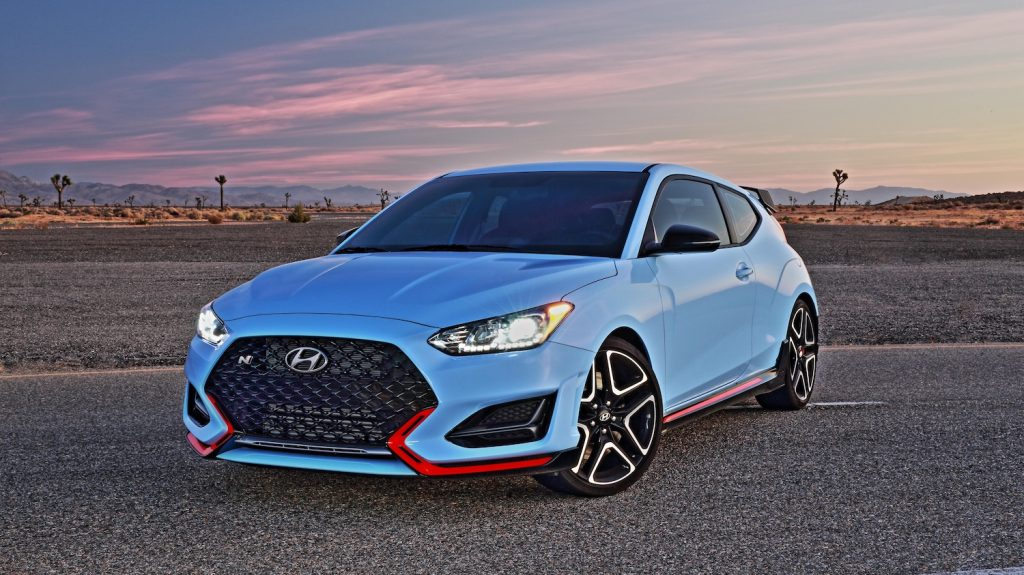 A blue 2021 Hyundai Veloster N at dusk, the 2021 Hyundai Veloster N is one of the fastest affordable new cars under $40,000