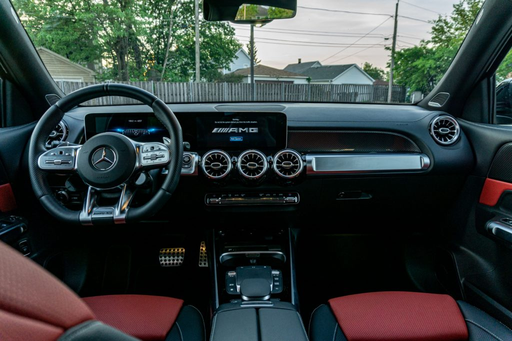 The black-and-red-leather front seats and the black dashboard of a 2021 Mercedes-AMG GLB 35