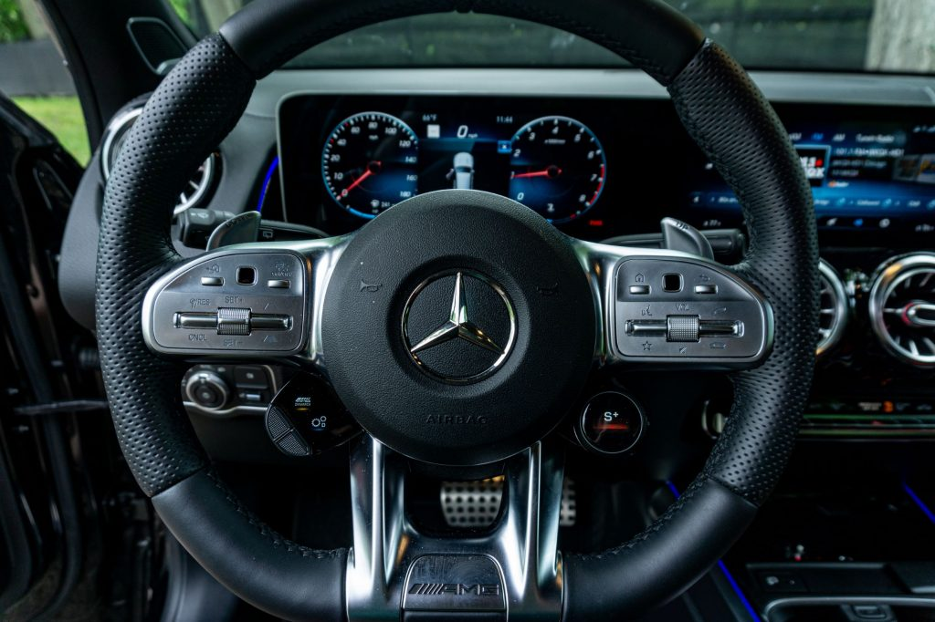 The steering wheel of a 2021 Mercedes-AMG GLB 35 with the AMG Drive Unit