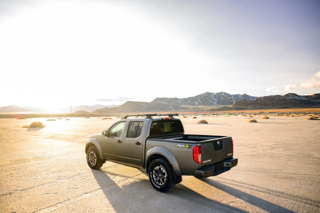 A 2021 Nissan Frontier at sunset, one of the best affordable new pickups under $30,000