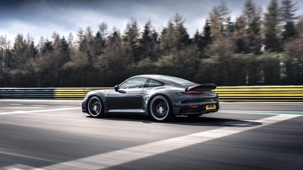 A grey 2021 Porsche 911 Carrera 4S Coupe on the track