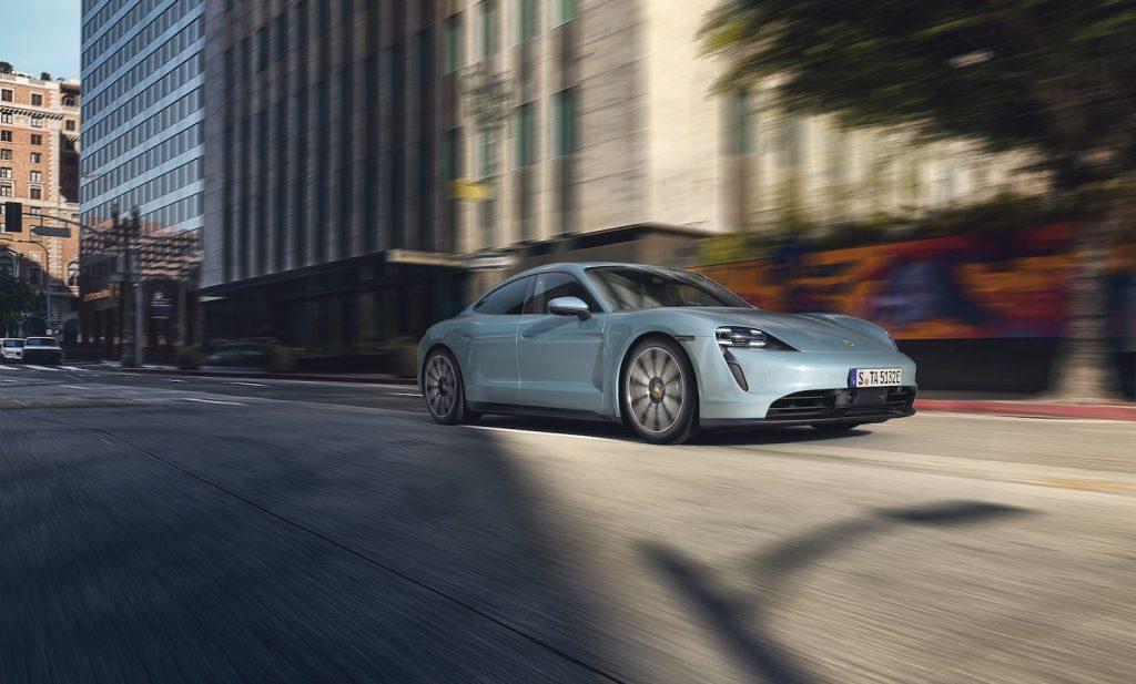 A light blue 2021 Porsche Taycan driving