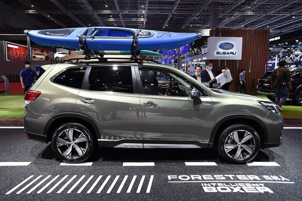 A green 2021 Subaru Forester at an auto show