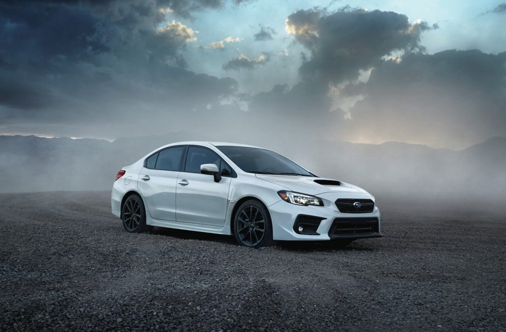 A white 2021 Subaru WRX parked, the 2021 Subaru WRX is one of the fastest new cars under $40,000