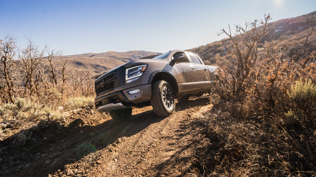 A Nissan Titan off-road, nose in the air