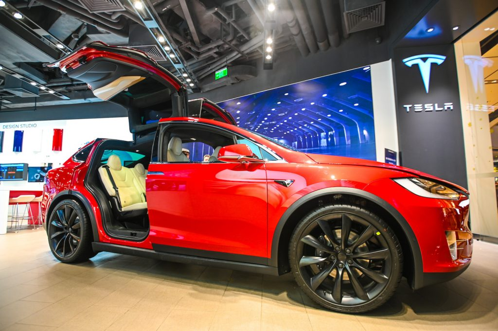 A red 2021 Tesla Model X at a car show, the Model X is the best luxury SUV for tall drivers