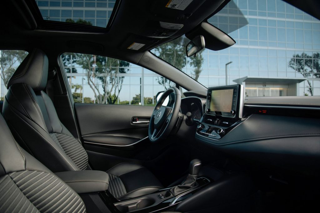 A side view of the black front seats and dashboard of a 2021 Toyota Corolla XSE Apex Edition