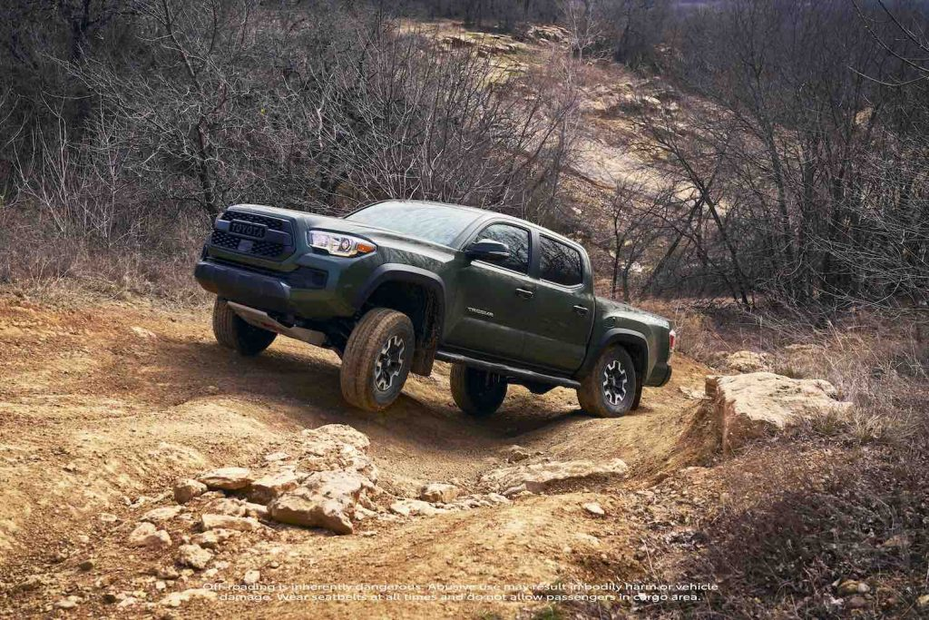 The 2021 Toyota Tacoma going off-roading, the Tacoma TRD Pro is one of the best new off-road pickups according to Edmunds