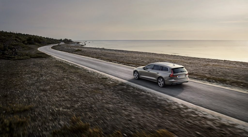 A 2021 Volvo V60 driving down an empty read, the V60 is one of the best plug-in hybrids, TrueCar reports