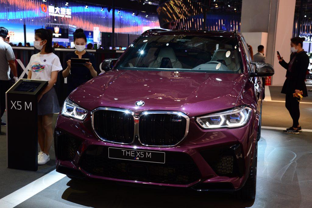 A purple 2021 BMW X5 luxury SUV on display