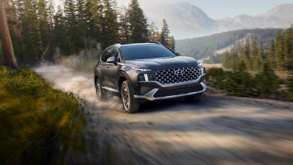 The 2022 Hyundai Santa Fe PHEV driving down a dirt road