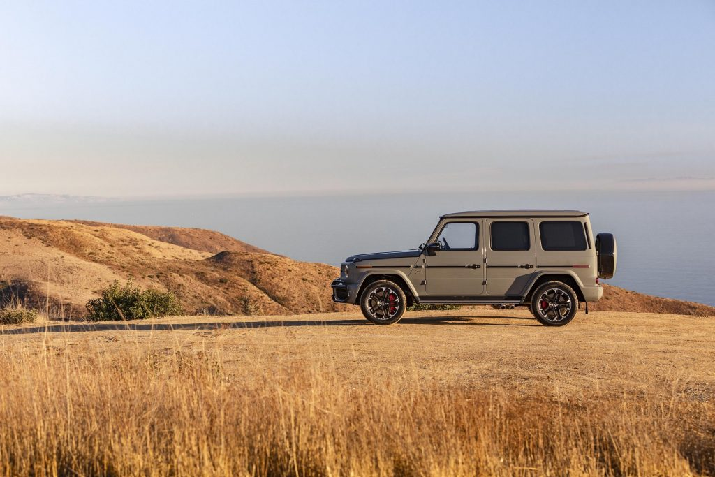 a 2021 Mercedes G-Class sitting on top of a mountain. This model is now the fastest-selling car in America
