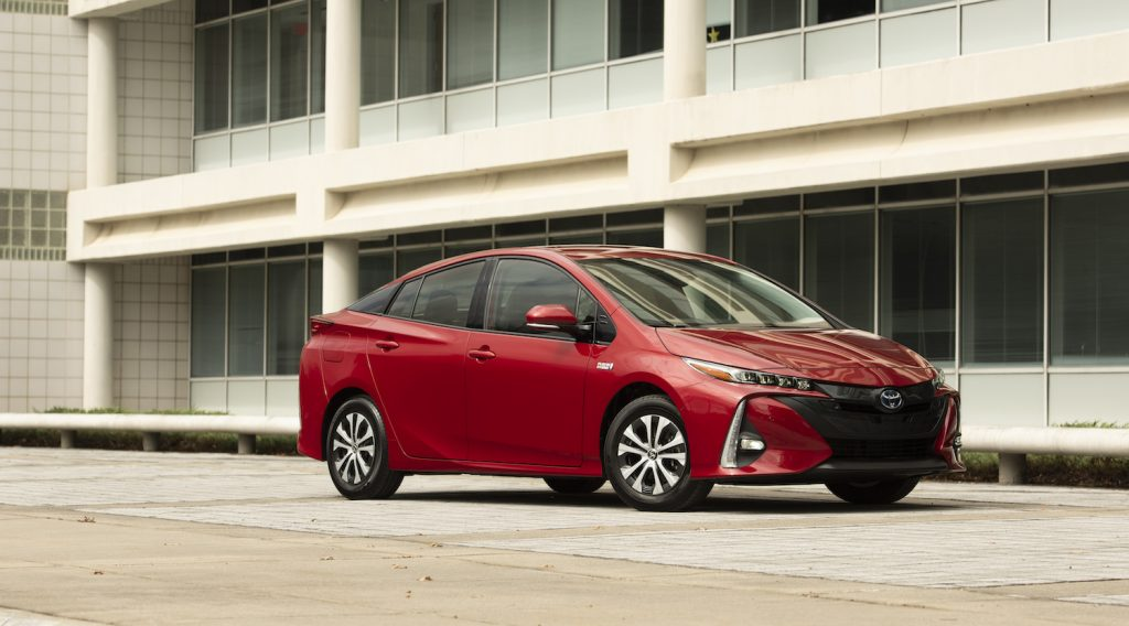 A red 2021 Toyota Prius Prime parked